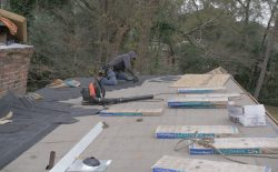 re-roofing a roof with roofers